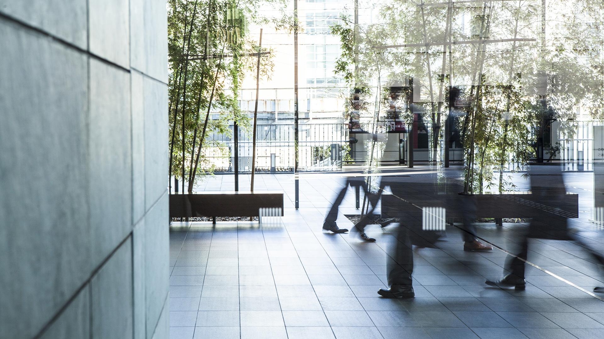 employees walking in modern building