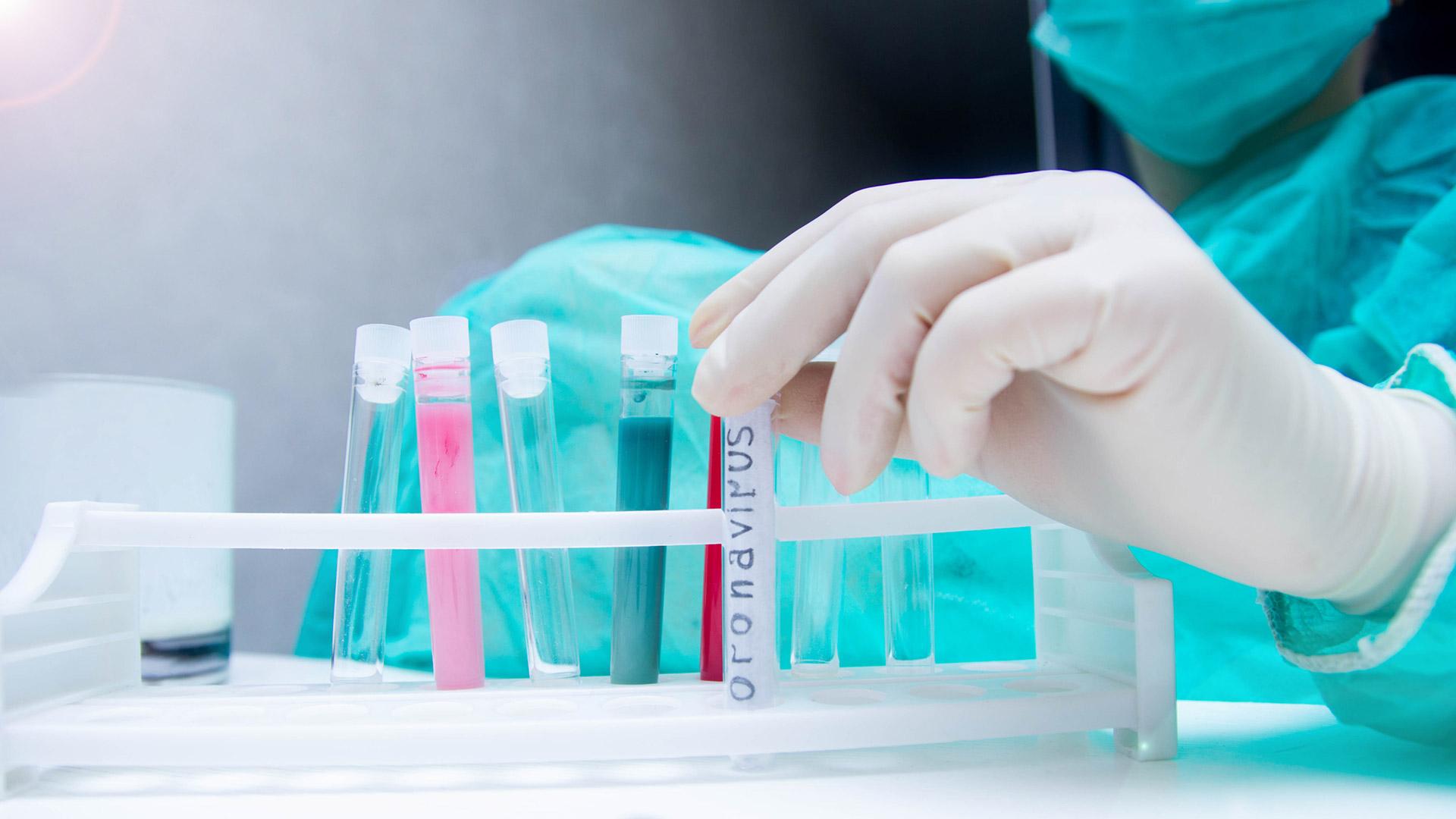 Image of test tubes, one labeled with coronavirus